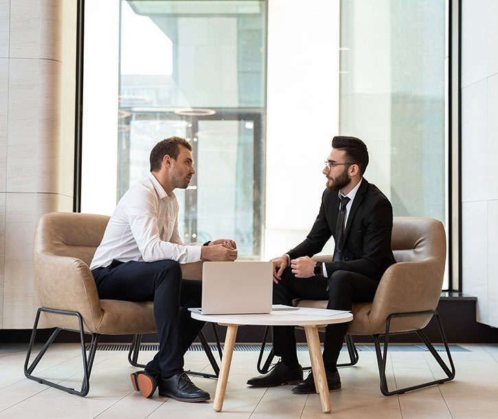 An agent is in meeting with client in office